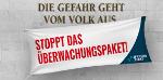 """Ein Schriftzug, """"Die Gefahr geht vom Volk aus"""", vor dem ein Banner """"Stoppt das Überwachungspaket! - epicenter.works"""" hängt."""